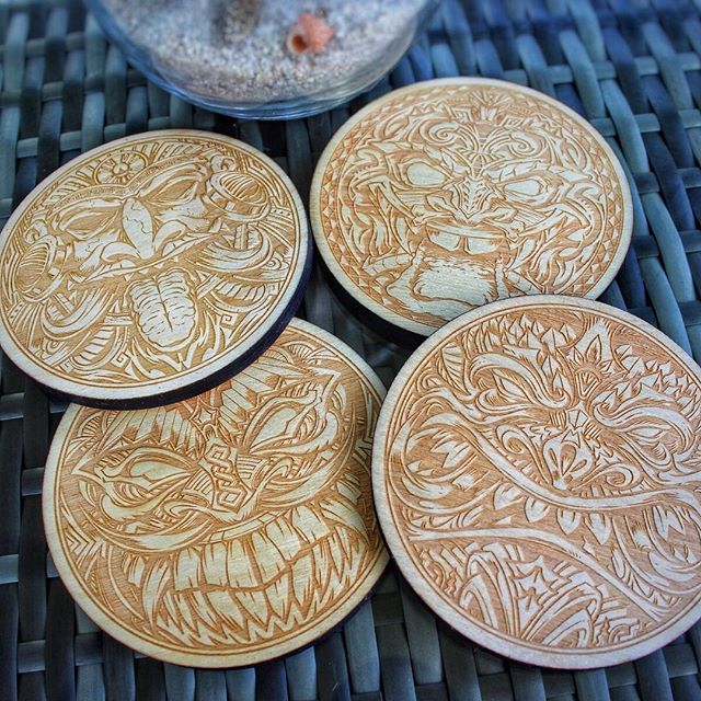 """So happy to release my first set of coasters! Intricite hand-drawn tiki artwork laser-engraved with a real space-laser in wood - 1/4"""" thick, 4"""" wide. Now available in my shop! https://www.flylanddesigns.com/shop/#coaster #tikiart #tikibar #beachart #tikitotem #surfart #tikiartist #beach #laserengraving"""
