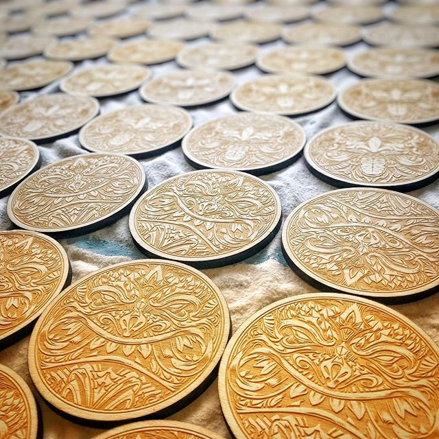 Man, thanks for all the positive feedback on these tiki coasters I designed (in my shop now)! I had my artwork laser-engraved by @graffitipete and they did an amazing job. I took them to an art festival this weekend and they did very well. Look at that texture - don't you just want to roll around on them?#tikiart #tikibar #beachart #tikitotem #surfart #tikiartist #beach #laserengraved #coasters