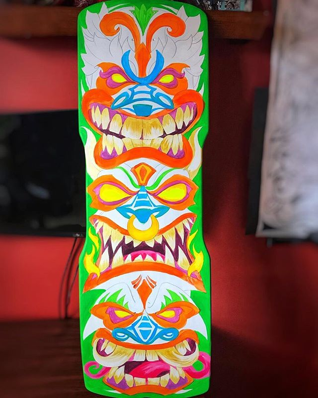 Blocking in colors on this custom skateboard deck painting I was working on. I used some left-over black light paint for the eyes to really make them glow. You can't see it in the photo, but I used some metallic gold paint I had for the teeth, and cut it with white, so they have a really cool subtle sheen to them.#skateboardart #deckart #skaterart #deckdesign #skateboarding#tikiart #tikibar #beachart #tikitotem #surfart #tikiartist #beach