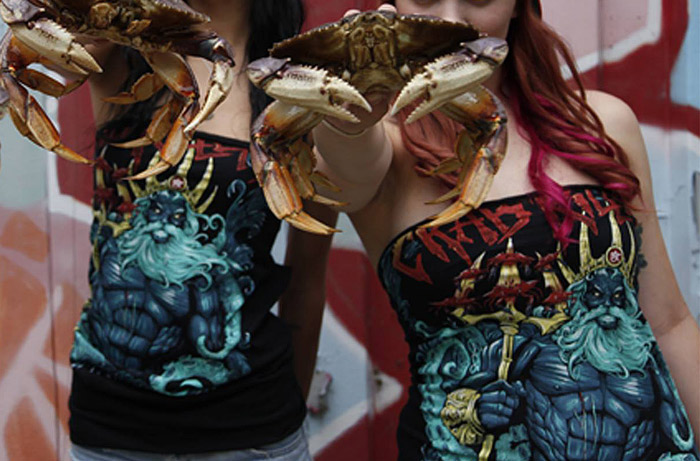 Photo of two girls holding crabs wearing the Crab Killer T-Shirt by 5-Star