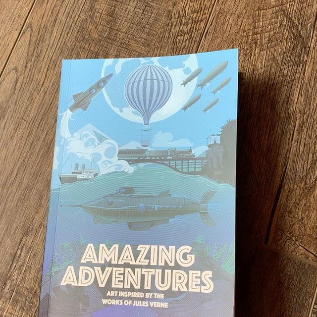 """Just received the """"Amazing Adventures"""" art gallery book from Little Chimp Society featuring my Jules Verne Journey to the Center of the Earth artwork. So happy to have been apart of such a talented group!#julesverne #journeytothecenteroftheearth #posterart #posterartist #artbooks"""